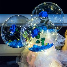 Luminous 3 Blue roses or blue orchids inside 3 transparent balloon with White and Blue Wrapping