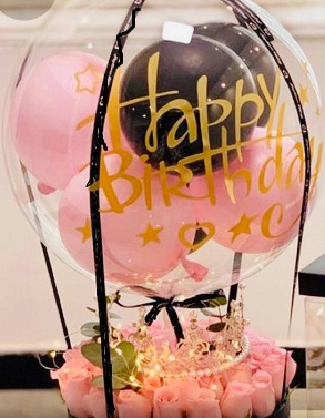 30 pink roses basket tied to hot air balloon printed Happy Birthday with pink balloons inside
