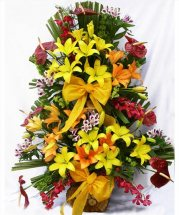 Large arrangement of lilies in Basket
