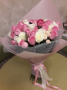 40 Pink and White roses in net packing