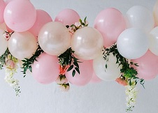 15 Pink and white balloons decorated with flowers and foliage