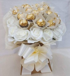 24 white roses with 16 pieces of ferrero rocher chocolates with white ribbons