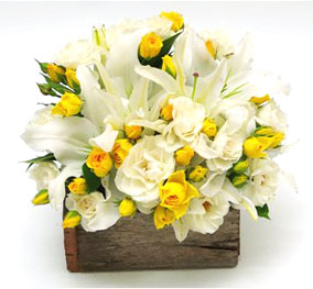 12 Yellow and 4 white lilies basket