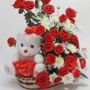 Red roses white carnations teddy in same basket