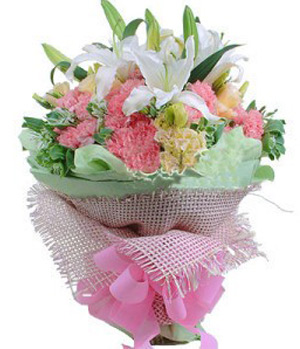 Pink carnations with white lilies in a bouquet
