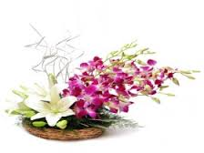 Purple Orchids White Lilies in basket