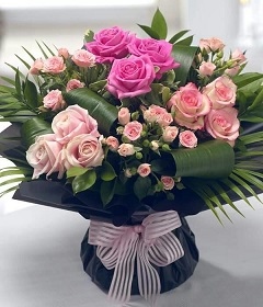 20 Light and dark pink roses in a bouquet