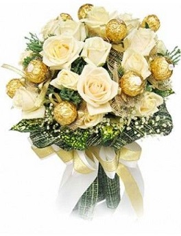 16 Ferrero rocher chocolates and 10 white roses in a bouquet