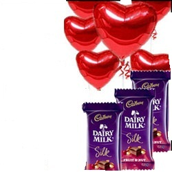 6 Red Heart air filled balloons with 3 Silk chocolates