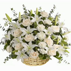 White Lilies with white roses in a basket