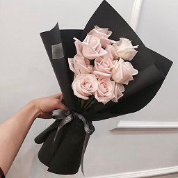 10 baby pink roses in black paper and ribbons