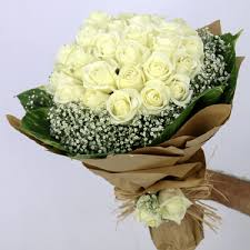 20 White roses in brown paper and white ribbons