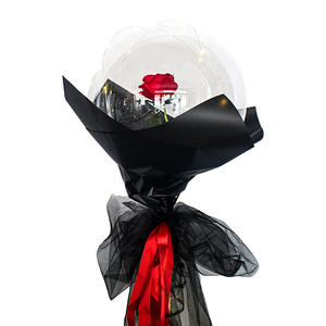 Red Rose enclosed in a Transparent Balloon with black wrapping tied with Red ribbons