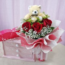 Teddy bear(6 inches) 3 Red roses in a basket