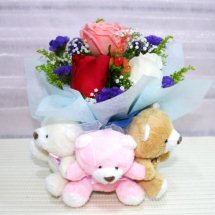 Three Teddies holding a bouquet of 1 red 1 white 1 pink rose