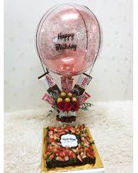 Happy Birthday printed hot air balloon with 5 Ferrero Rocher chocolates 5 dairy milk small chocolates in basket Cake 1 kg Fresh Fruit