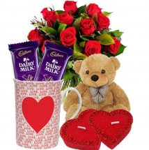 2 valentine hearts 1 Teddy 2 Silk chocolates 1 coffee mug 12 Red roses
